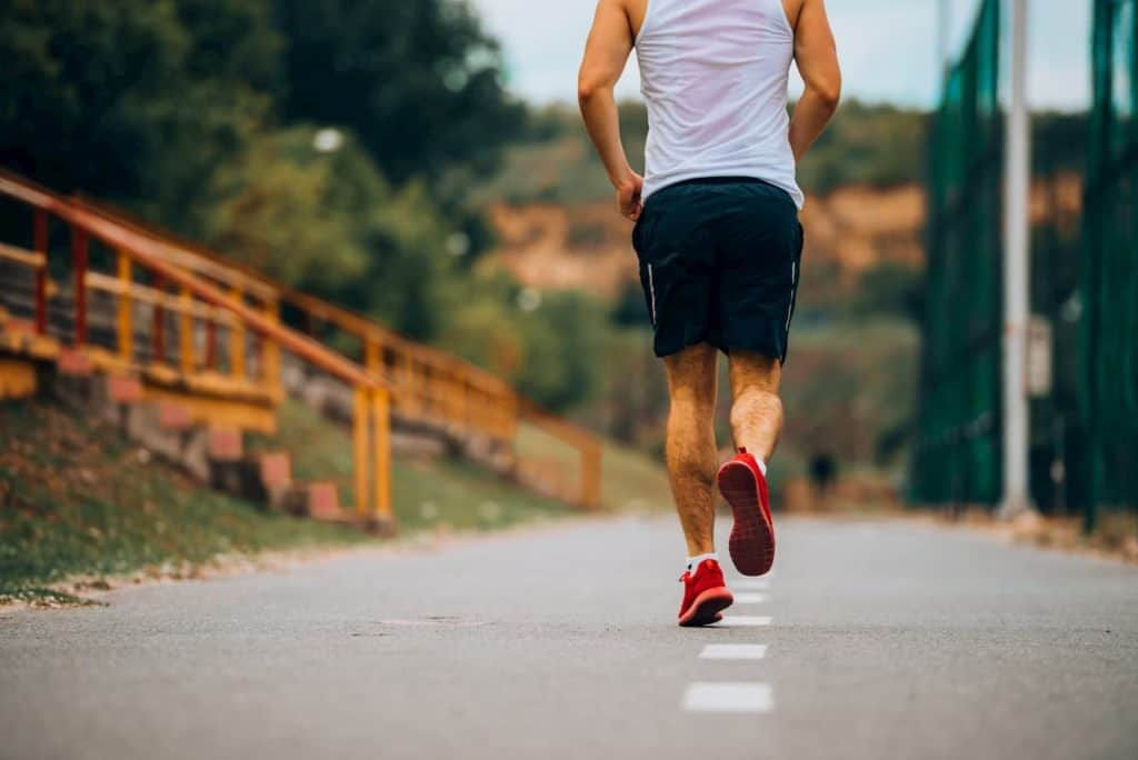 Running outdoors on a track is a healthy way to track - post on How Long Should I Run and How Many Miles For Fitness