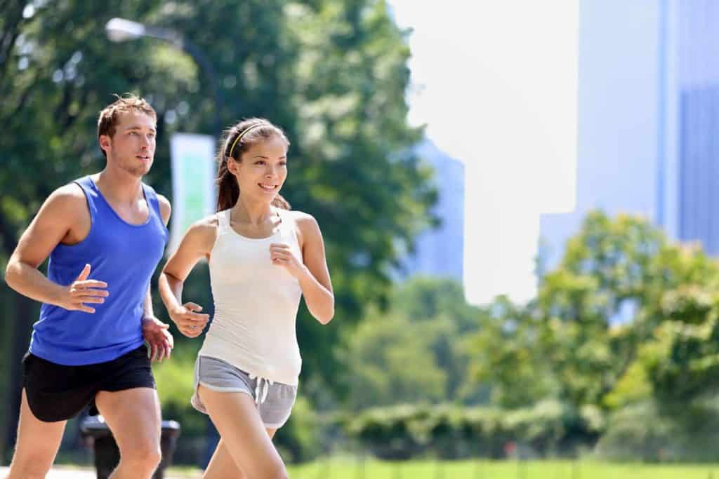 Runners jogging in New York City Central Park - Post on How Often Should You Do Cardio