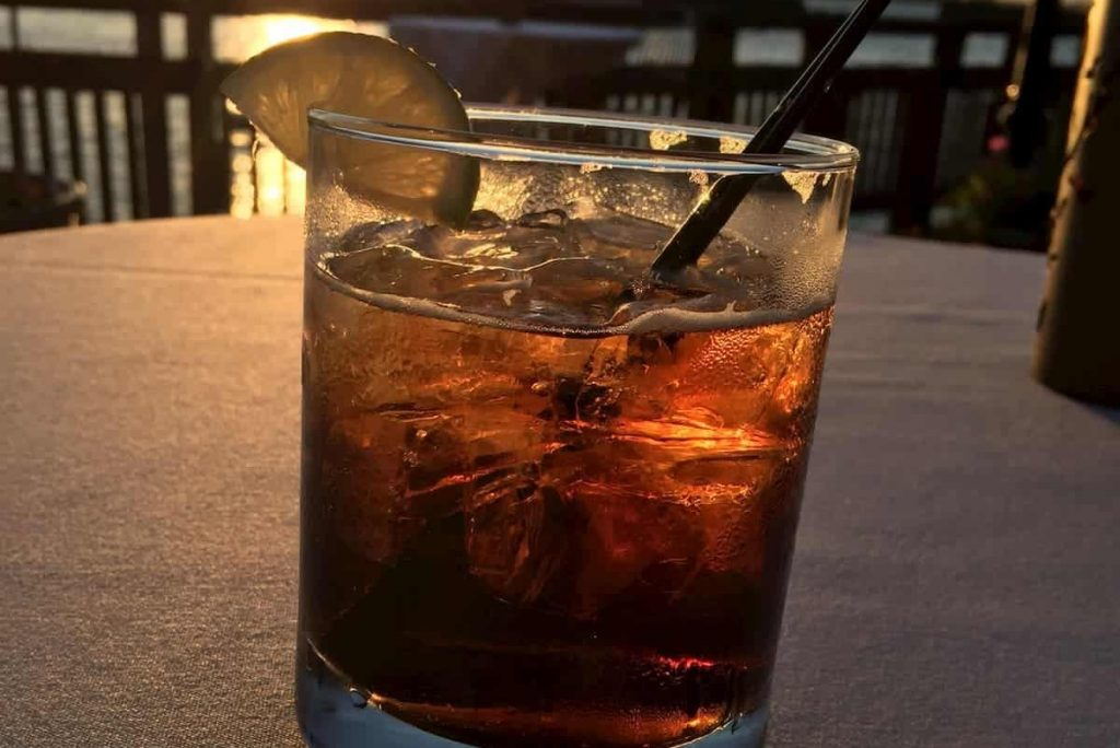 Jack and Coke at sunset on the waterfront in downtown - Can You Drink Alcohol On Keto